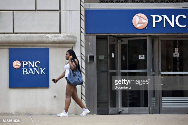 A pedestrian passes in front of a PNC Financial Services Group Inc bank branch in Peoria Illinois US on Monday July 10 2017 PNC Financial Services...