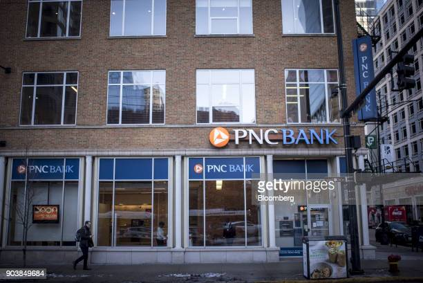 A pedestrian passes in front of a PNC Financial Services Group Inc bank branch in downtown Chicago Illinois US on Monday Jan 8 2018 PNC Financial...