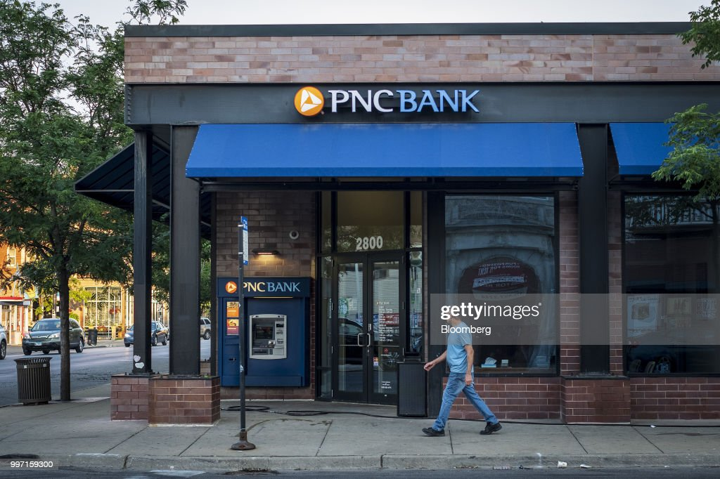 A pedestrian passes in front of a PNC Financial Services Group Inc. bank branch in Chicago, Illinois, U.S., on Thursday, July 12, 2018. PNC Financial Services Group Inc. is scheduled to release earnings figures on July 13. Photographer: Christopher Dilts/Bloomberg via Getty Images