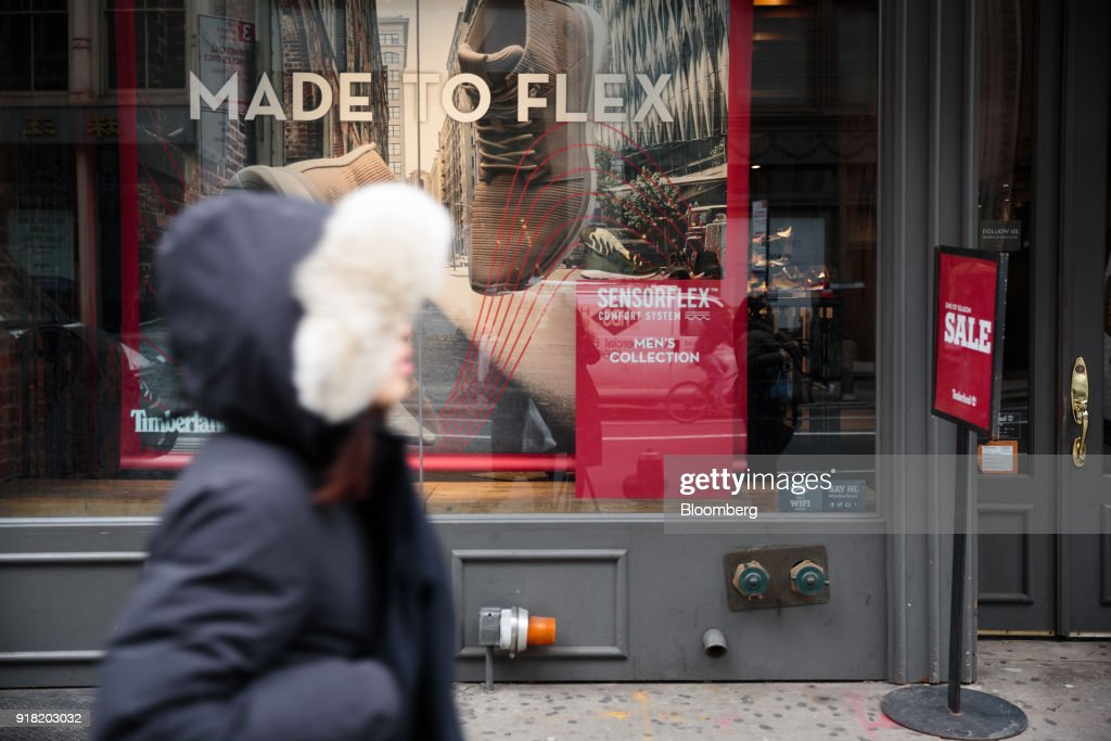 A pedestrian passes in front of a Timberland LLC store in the SoHo neighborhood of New York, U.S., on Friday, Feb. 9, 2018. Bloomberg is scheduled to release consumer comfort figures on February 15. Photographer: Sarah Blesener/Bloomberg via Getty Images