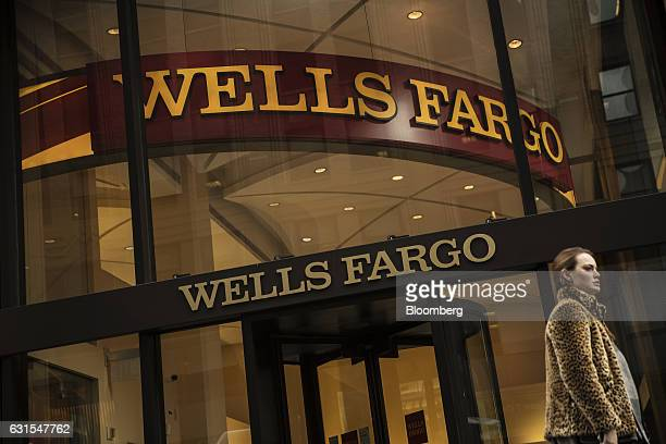 A pedestrian passes in front of a Wells Fargo Co bank branch in New York US on Wednesday Jan 11 2017 Wells Fargo Co is scheduled to release earning...