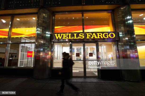 A pedestrian passes in front of a Wells Fargo Co bank branch in New York US on Tuesday Jan 9 2018 Wells Fargo Co is scheduled to release earnings...
