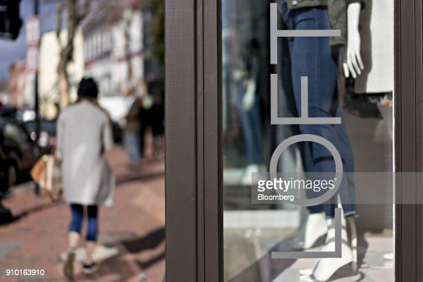 A pedestrian passes in front of an Ann Taylor Inc Loft store in the Georgetown neighborhood of Washington DC US on Wednesday Jan 24 2018 Workers at...