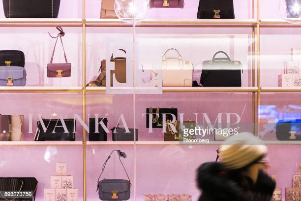 A pedestrian passes in front of an Ivanka Trump brand store at Trump Tower in New York US on Thursday Dec 14 2017 Trump's new store marks her second...