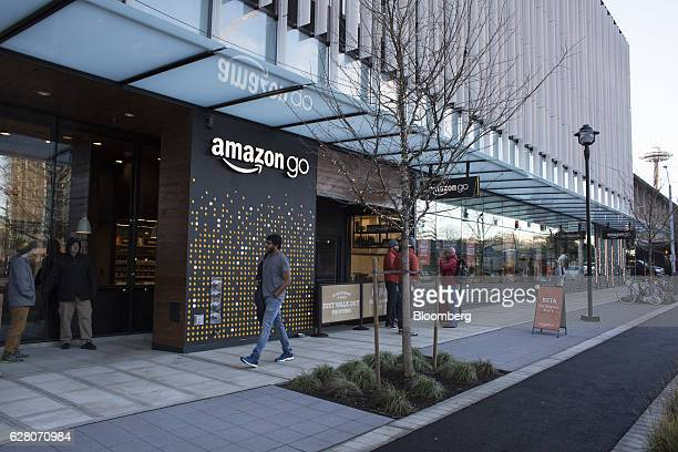 A pedestrian passes in front of the new Amazon Go grocery store in Seattle Washington US on Tuesday Dec 6 2016 Amazoncom Inc unveiled technology that...