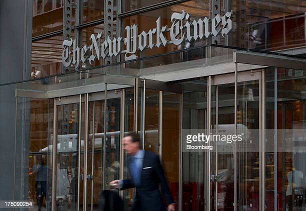 A pedestrian passes in front of The New York Times Co offices in New York US on Wednesday July 31 2013 The New York Times Co is scheduled to release...