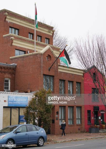 A pedestrian passes infront of the Palestine Liberation Organisation offices in Washington DC on November 18 2017 The Palestinians will freeze their...