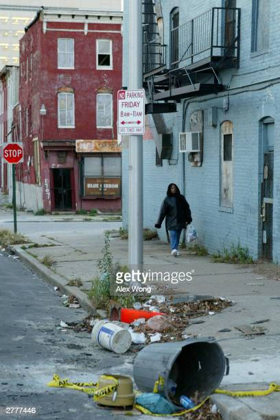 A pedestrian passes litter in the Middle East neighborhood three blocks north of Johns Hopkins University Medical School December 2 2003 in East...