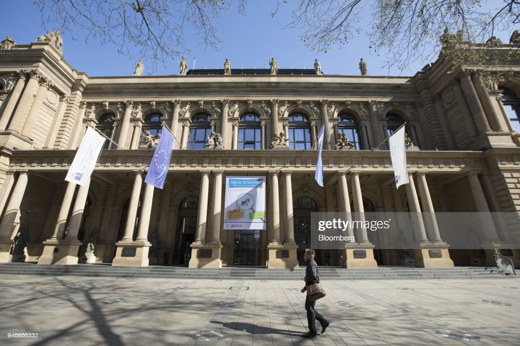 A pedestrian passes outside the Frankfurt Stock Exchange, operated by Deutsche Boerse AG, in Frankfurt, Germany, on Monday, April 16, 2018. Bonds declined, stocks were steady and oil fell on anticipation that the fallout from missile strikes in Syria will be limited. Photographer: Alex Kraus/Bloomberg via Getty Images
