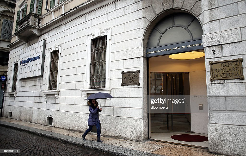 A pedestrian passes the Banco Popolare SC headquarters in Verona, Italy, on Monday, March 25, 2013. Italy's economy remains mired in its longest recession in two decades and a month-old political impasse threatens to increase sovereign-debt yields and bank funding costs. Photographer Alessia Pierdomenico/Bloomberg via Getty Images