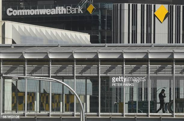 A pedestrian passes the Commonwealth Bank headquarters in Sydney on August 10 2016 Australia's biggest bank the Commonwealth sounded a cautious note...