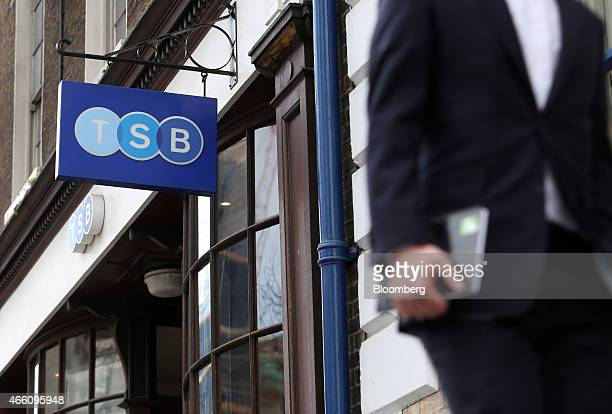 A pedestrian passes the entrance to a TSB bank branch operated by TSB Banking Group Plc in London UK on Friday March 13 2015 Banco de Sabadell SA...