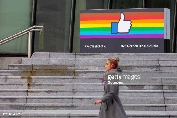 Pedestrian passes the Facebook Inc. European headquarters in Dublin, Ireland, on Thursday, Oct. 15, 2020. Office vacancy rate rose from 6.65% at end...