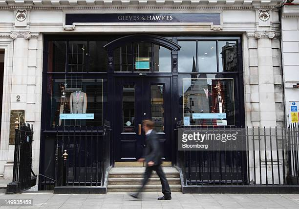 A pedestrian passes the Gieves Hawkes store owned by Trinity Ltd on Savile Row in London UK on Tuesday Aug 7 2012 UK retail sales rose in July as the...