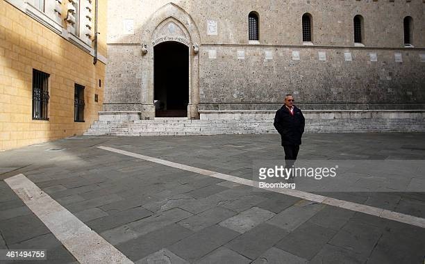 A pedestrian passes the headquarters of Banca Monte dei Paschi di Siena SpA in Siena Italy on Wednesday Jan 8 2014 Monte Paschi the bailed out...