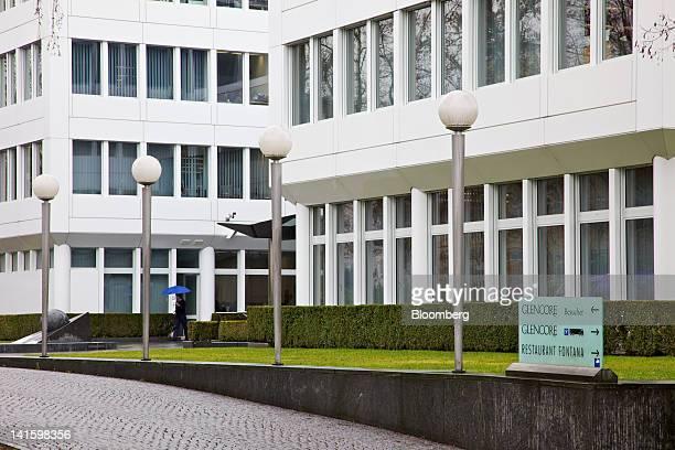 Pedestrian passes the headquarters of Glencore International Plc in Baar, Switzerland, on Monday, March 19, 2012. Glencore International Plc Chief...