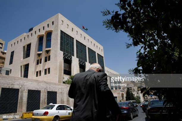 A pedestrian passes the headquarters of Jordan's central bank in Amman Jordan on Thursday June 21 2018 President Trump and First Lady Melania Trump...