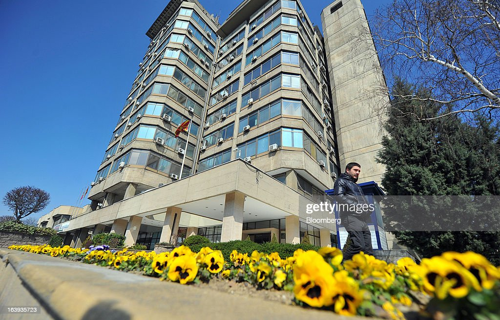 A pedestrian passes the headquarters of Macedonia's central bank in Skopje, Macedonia, on Sunday, March 17, 2013. Macedonia's economy contracted by a real 0.3% on the year in 2012, compared to a growth of 2.8% a year earlier, an estimate released by the country's statistics office showed. Photographer: Oliver Bunic/Bloomberg via Getty Images