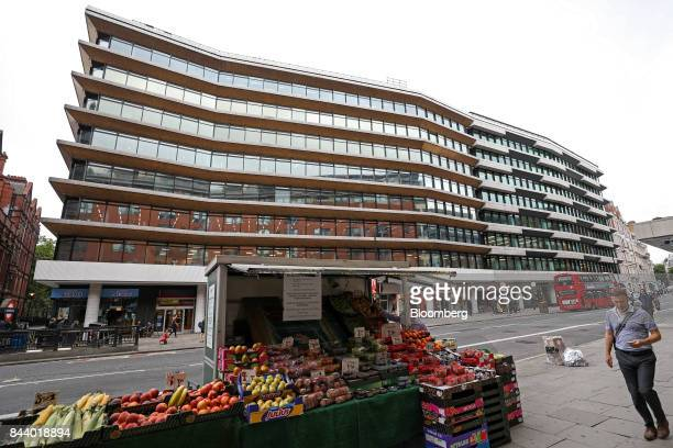 A pedestrian passes the offices which house the headquarters of Bell Pottinger LLP in London UK on Tuesday Sept 5 2017 Bell Pottinger LLP's attempt...