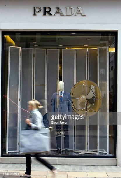Pedestrian passes the Prada boutique on Old Bond Street in London, U.K., on Thursday, May 19, 2011. Prada SpA, the Italian producer of Miu Miu bags...