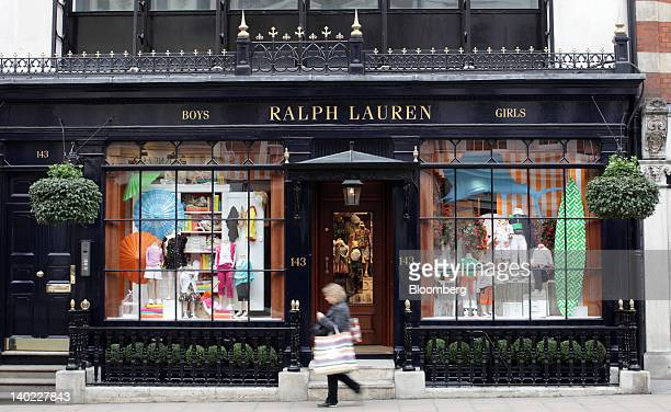 A pedestrian passes the Ralph Lauren Corp store for children on New Bond Street in London UK on Wednesday Feb 29 2012 Bank of England Deputy Governor...