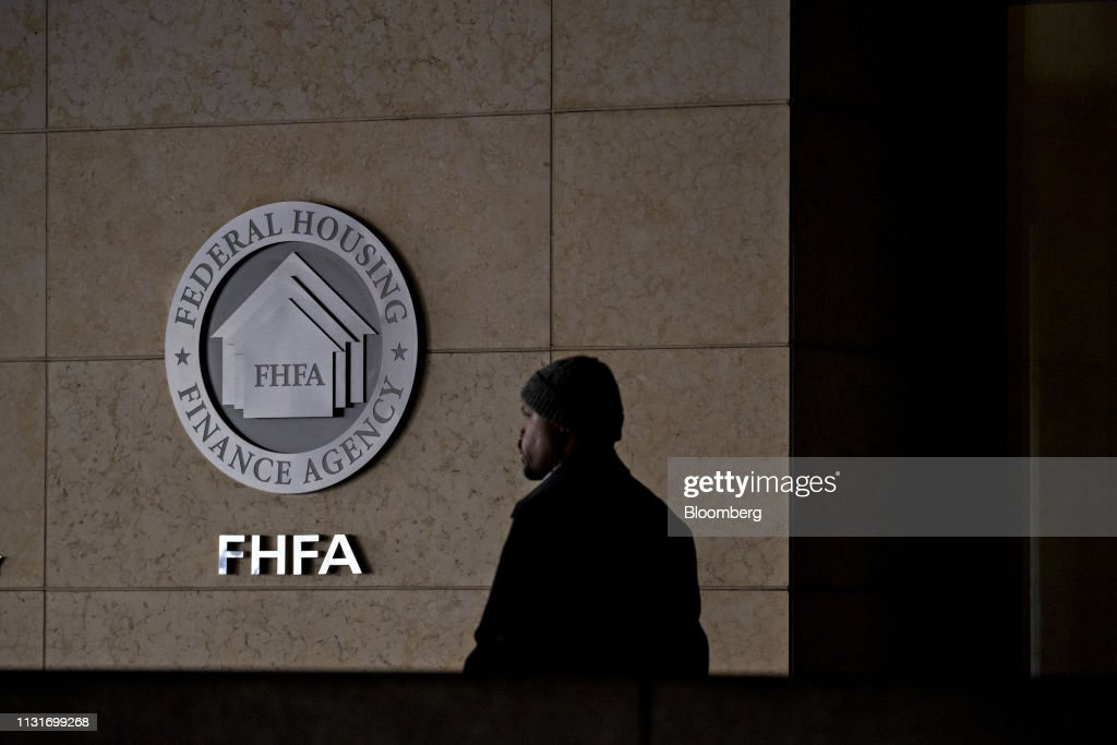 A pedestrian passes the seal of the Federal Housing Finance