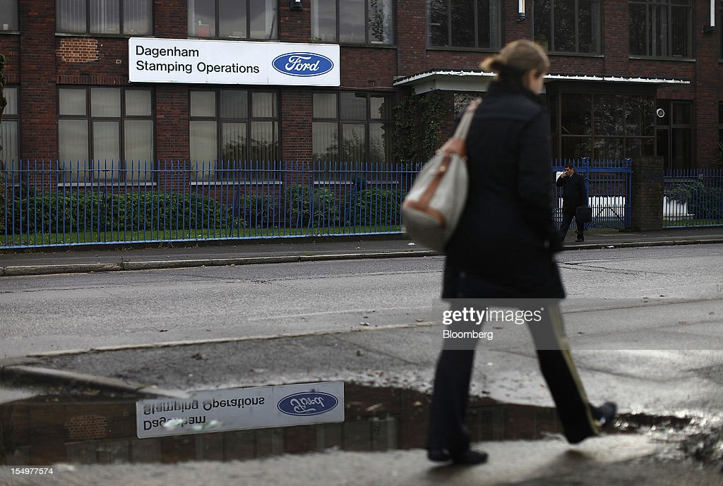 A pedestrian passes the stamping operations area of the Ford Motor Co. automobile plant in Dagenham, U.K., on Monday, Oct. 29, 2012. Ford Motor Co. will shut three European plants, its first factory closings in the region in a decade, and cut 5,700 jobs to stem losses that the carmaker predicts will total more than $3 billion over two years. Photographer: Simon Dawson/Bloomberg via Getty Images