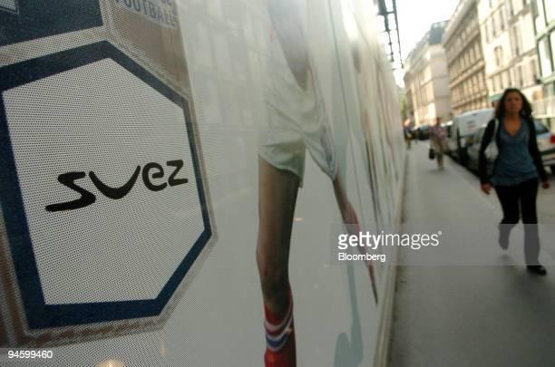 Pedestrian passes the Suez headquarters in Paris, France, Friday, June 23, 2006.