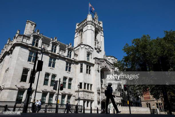A pedestrian passes the Supreme Court in London UK on Tuesday July 24 2018 Scotland's bid to ensure that it retains a high degree of authority over...