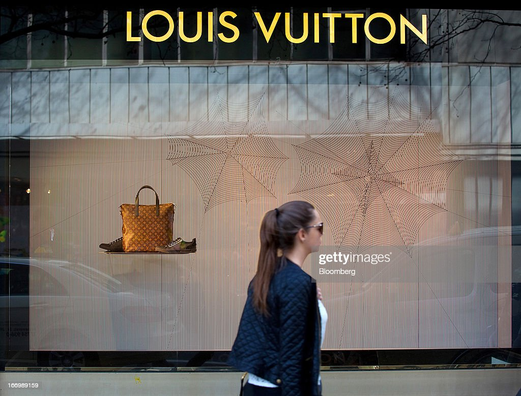 A pedestrian passes the window display for Louis Vuitton, a unit of LVMH Moet Hennessy Louis Vuitton SA, at the KaDeWe, or Kaufhaus des Westens department store in Berlin, Germany, on Thursday, April 18, 2013. Germany's economy is shrugging off a contraction at the end of last year and starting to grow due to revived exports and rising private consumption, the country's leading economic institutes said. Photographer: Krisztian Bocsi/Bloomberg via Getty Images
