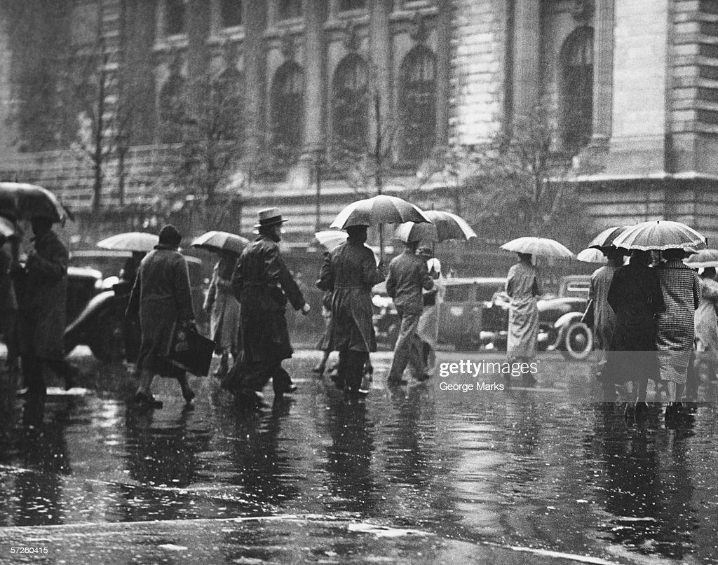 Pedestrian passing street, rainy weather, New York, USA (B&W) : Stock Photo