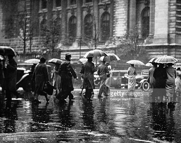 pedestrian passing street, rainy weather, new york, usa (b&w) - history stock pictures, royalty-free photos & images