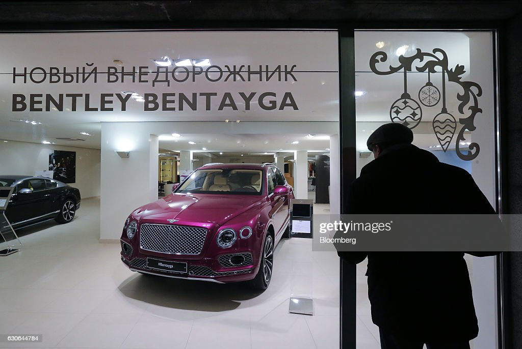 A pedestrian pauses to look at a Bentley Bentayga SUV in the Bentley automobile dealership on Tretyakov Drive in Moscow, Russia, on Thursday, Dec. 29, 2016. President-elect Donald Trump said Wednesday that the U.S. should move on rather than retaliate against Russia for interfering in the 2016 election, with the Obama administration expected to soon take action against Moscow. Photographer: Andrey Rudakov/Bloomberg via Getty Images