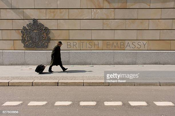 Pedestrian pulling a suitcase walks past the exterior of the British Embassy, the United Kingdom's diplomatic mission to Germany in Berlin. It is...