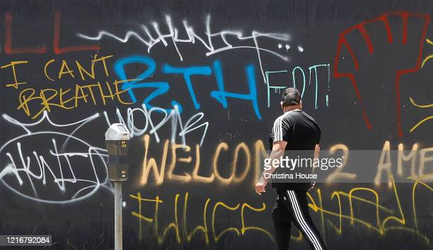 A pedestrian reads graffiti on 3rd Street in the Fairfax District on Sunday May 31 2020