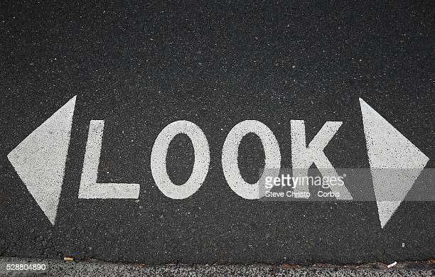 Pedestrian road sign 'LOOK' warning you to take care when crossing the road Sydney Australia Monday 2nd December 2013