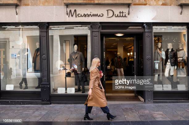 A pedestrian seen walking past a Spanish clothing manufacturing and brand Massimo Dutti in Salamanca