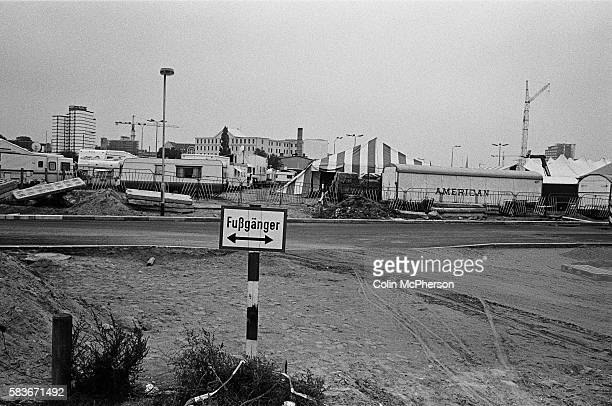 A pedestrian sign and a circus on the former course of the Berlin Wall Potsdamer Platz Berlin The Berlin Wall was a barrier constructed by the German...