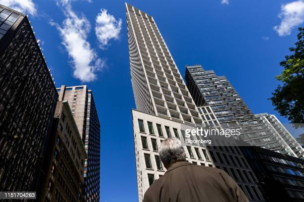 A pedestrian stands in front of the AvalonBay Communities Inc Park Loggia condominium in New York US on Wednesday May 15 2019 AvalonBay Communities...