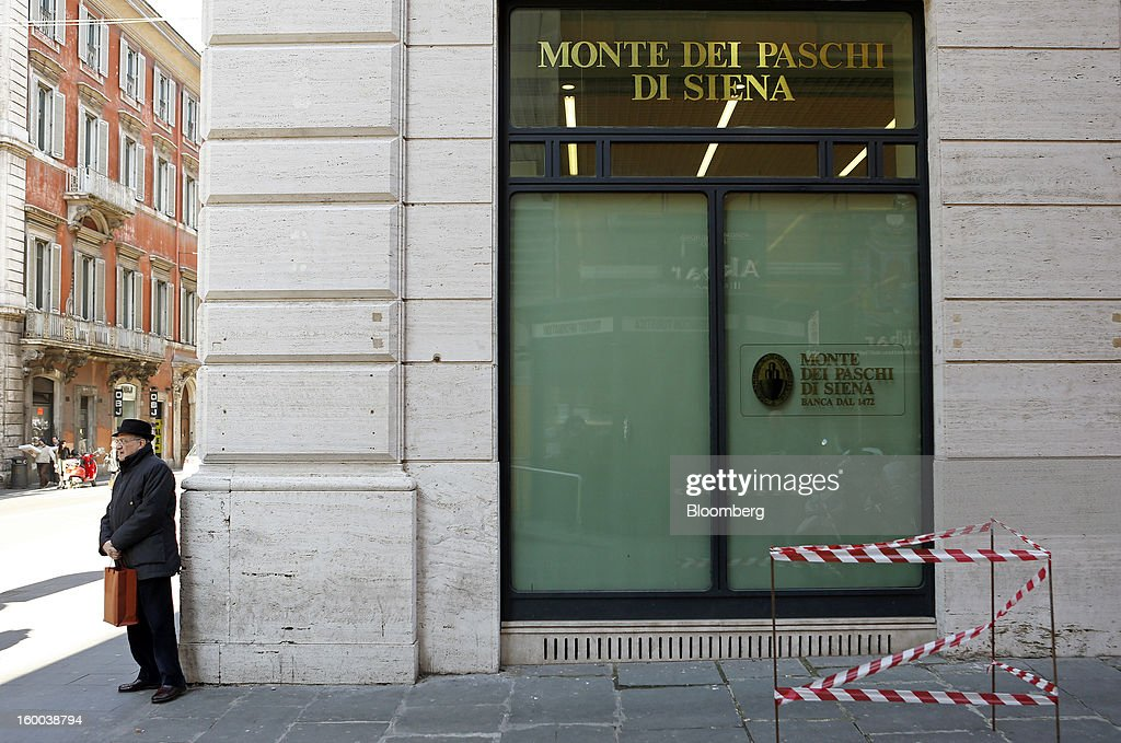 A pedestrian stands outside a Banca Monte dei Paschi di Siena SpA bank branch in Rome, Italy, on Friday, Jan. 25, 2013. Italian Prime Minister Mario Monti said the Bank of Italy will take another look at Banca Monte dei Paschi di Siena SpA's books after the company disclosed this week it may face more than 700 million euros of losses related to structured finance transactions hidden from regulators. Photographer: Alessia Pierdomenico/Bloomberg via Getty Images