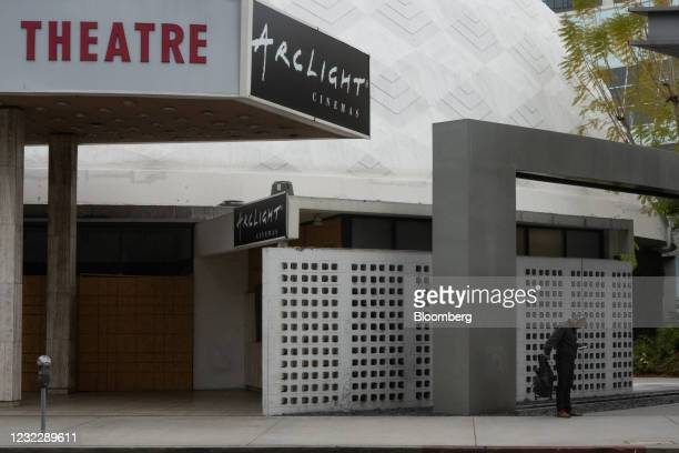Pedestrian stands outside the Pacific Theatres' Cinerama Dome, part of the ArcLight Hollywood complex, permanently closed in Hollywood, California,...
