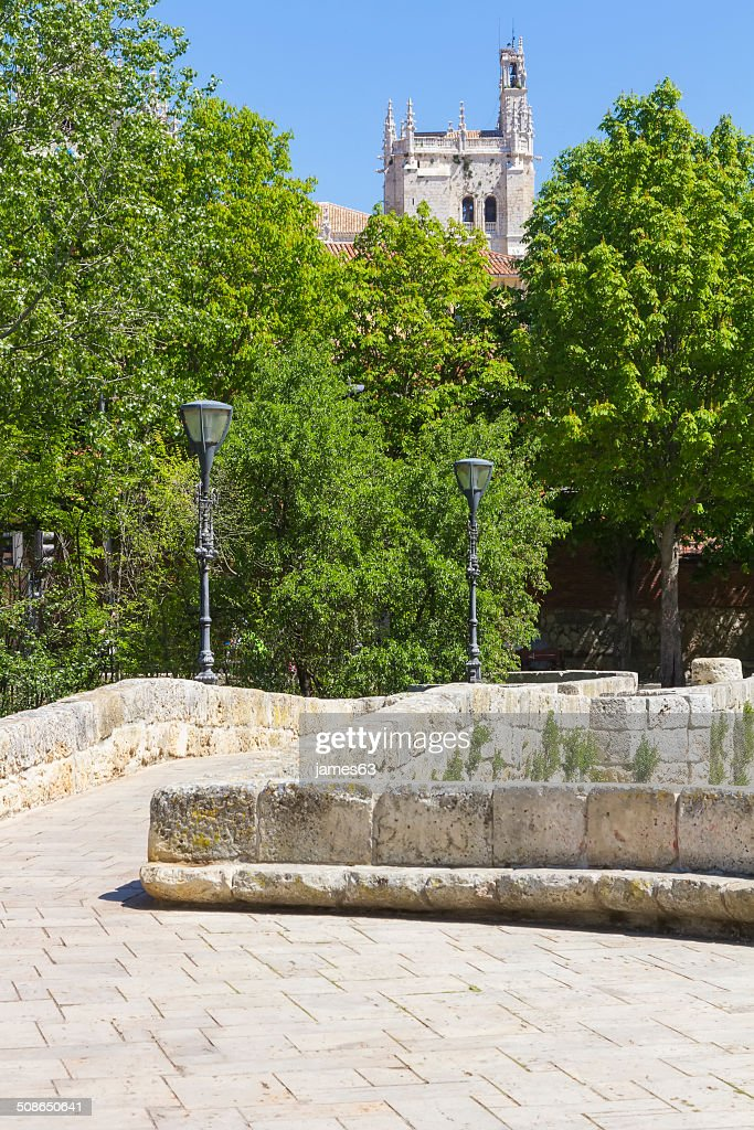 Pedestrian stone bridge, with church in the background : Stock Photo