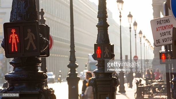pedestrian stop signs, paris, france - pedestrian crossing sign stock photos and pictures