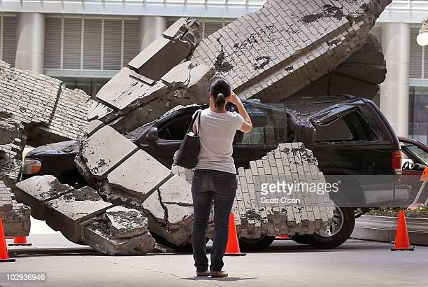 A pedestrian stops to photograph a movie prop staged along Wacker Drive during the filming of the movie Transformers 3 on July 16 2010 in Chicago...
