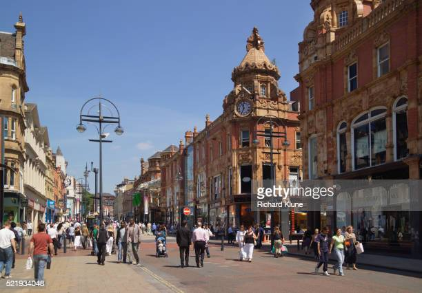 pedestrian street in briggate, leeds - leeds stock pictures, royalty-free photos & images