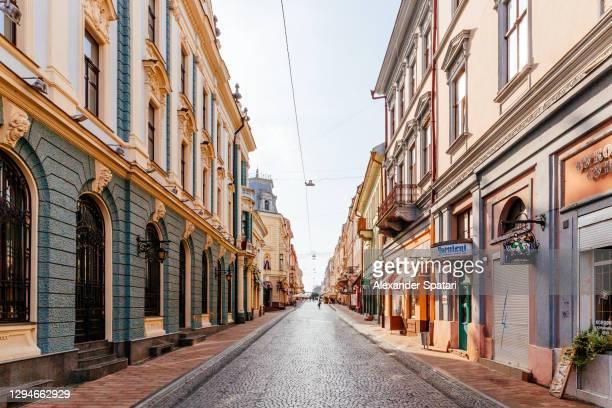 pedestrian street in chernivtsi historical center, ukraine - cobblestone stock pictures, royalty-free photos & images