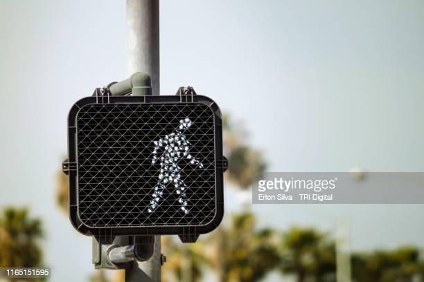 pedestrian street sign with walk light warning turned on - walk don't walk signal stock pictures, royalty-free photos & images