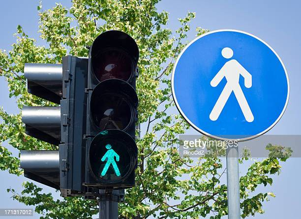 pedestrian symbol on traffic light and road sign - walk don't walk signal stock pictures, royalty-free photos & images