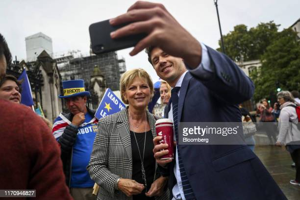 A pedestrian takes a selfie photograph with Anna Soubry UK lawmaker center near the Houses of Parliament in London UK on Wednesday Sept 25 2019 Boris...