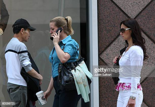 A pedestrian talks on her cellular phone as she walks down the street July 24 2008 in San Francisco California Dr Ronald B Herberman director of the...